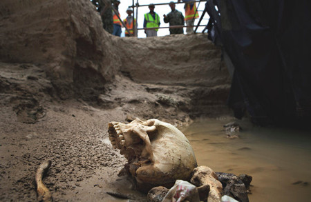 A human skull and bones at a mass grave near the Afghan town of Mazar-i-Sharif