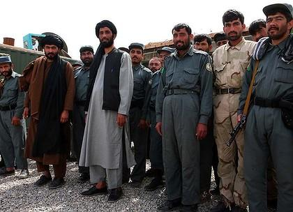 Matiullah Khan, stands with co-workers deciding who may use the road between Kandahar and Tarin Kowt