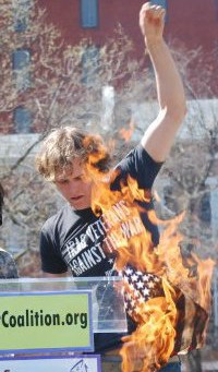 Matthis Chiroux burning the US flag