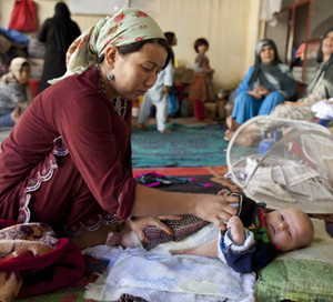 Prisoner Sara Gul changes her baby's diaper inside the women's prison in Afghanistan