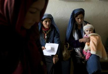 Afghan mothers visit a health clinic in Eshkashem district of Badakhshan province, northeast of Kabul