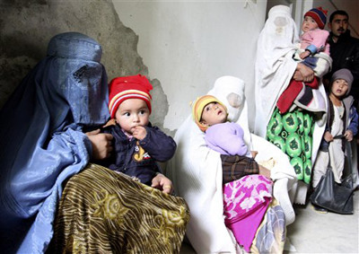 Mothers waiting for ration with their children.jpg