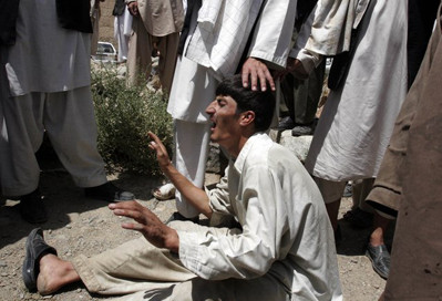 A mourner mourning his relatives killed in NATO raid