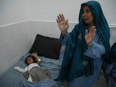 A child cries in the inpatient war of Boost Hospital in Helmand province of Afghanistan