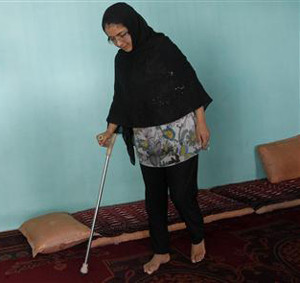 Muzhgan Masoomi walks in her house in Kabul
