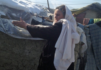 Nafas Gol says leaders in the camp she lives in hoard supplies donated by aid groups