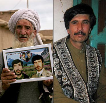 Haji Sharabuddin holds up a photo of his sons