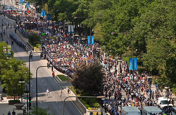 Thousands of protestors participating in an anti-war march walk south on Michigan Avenue for a rally near McCormick Place