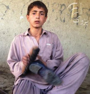Nizam, child cobbler whose income is snatched from him by the Taliban