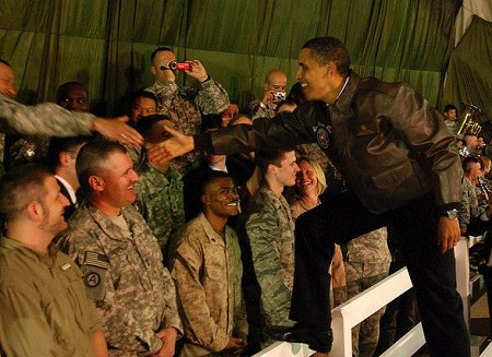 President Barack Obama greets deployed service members and civilians during a surprise visit to Bagram Airfield, Afghanistan