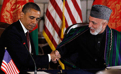 President Obama and Afghan President Hamid Karzai shake hands after making statements before signing a strategic partnership agreement