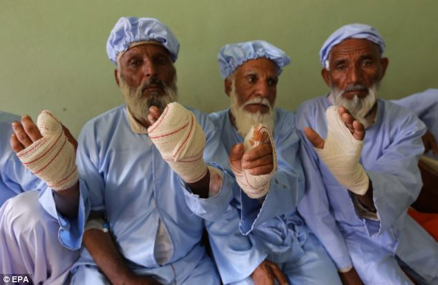 In Herat, these men had their index finger's amputated for ignoring the terror threat by Taliban to not vote