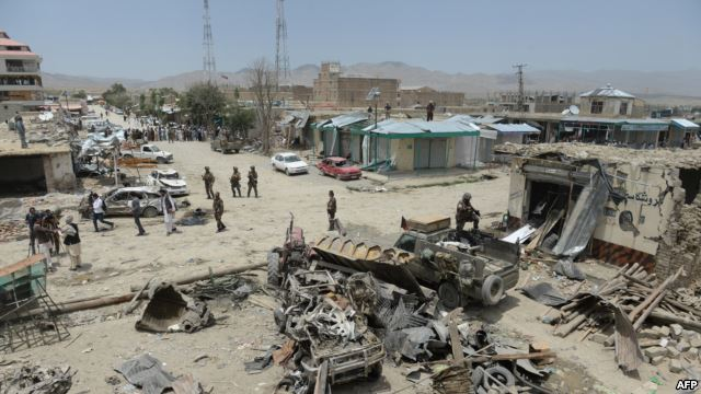Afghan security personnel keep watch at the scene of the July 15 suicide attack in Orgun district, Paktika