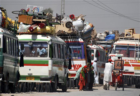 Afghan refugees getting ready to return home on the outskirts of Peshawar, Pakistan