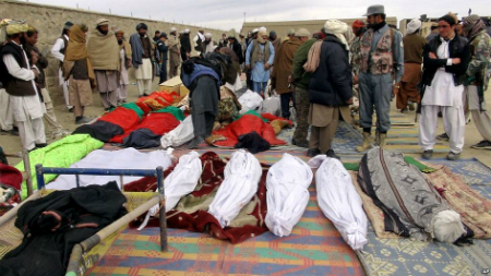 Bodies of victims killed from a suicide attack on Nov. 23, 2014 are laid on the ground in Paktika province, Afghanistan