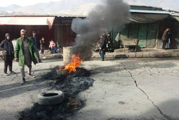 Residents from province protest the killing of three civilians in an operation carried out by foreign and Afghan forces