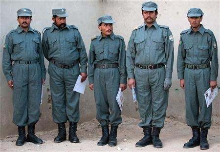 Graduate patrol men stand in line at the Helmand Police training centre near Lashkar Gah in this December 6, 2010 photo