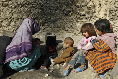 An Afghan family prepares tea for their breakfast in Kabul