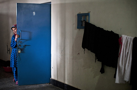 Prisoner outside her cell at Badam Bagh, Afghanistan's central women's prison in Kabu;