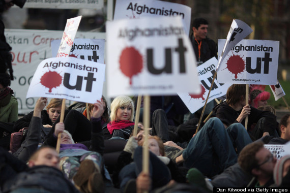 Students take part in a protest organised by the 'Stop the War Coalition', demanding that UK troops be withdrawn from Afghanistan