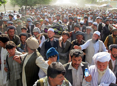 Ten people have been killed and fifty wounded in violent protests against the killing of two men and two women in a night-time raid in north Afghanistan, a top local health official said