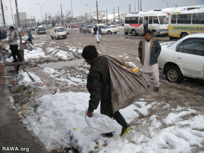 A child with his bag of garbage in Kabul