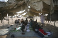 Afghan returnees huddle in tent camps
