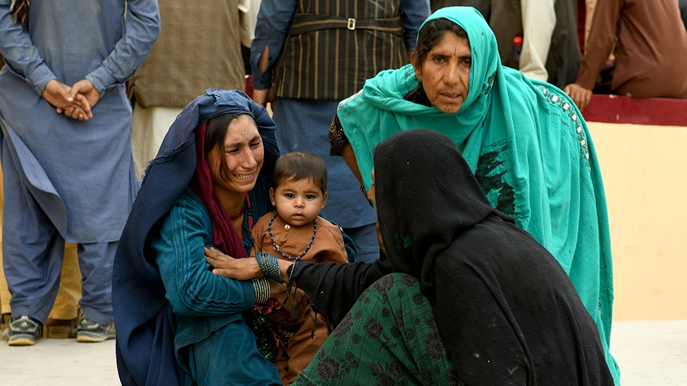 Relatives react in front of a hospital, where their family member has been transferred for treatment after a truck bomb blast in Balkh province border=