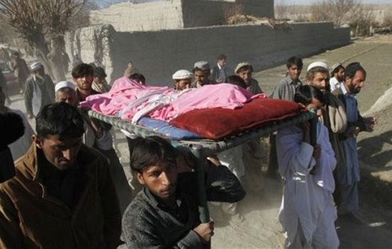 Relatives carry the body of an Afghan school boy