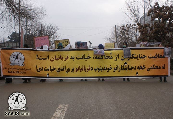 To mark the Universal Human Rights Day, SAAJS staged a protest rally in Kabul to ask for prosecution of war-criminals