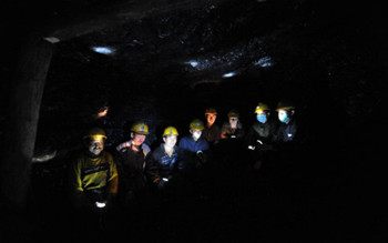 Afghan miners work inside a coal mine in Samangan province