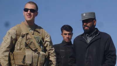 Shown here is Marine reservist Jason Brezler, left. At right is Sarwar Jan, an Afghan police official whom Brezler warned his fellow Marines about