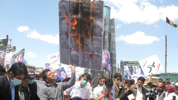 Towards the end a huge board bearing photos of more than thirty warlords was burnt by a group of youngsters