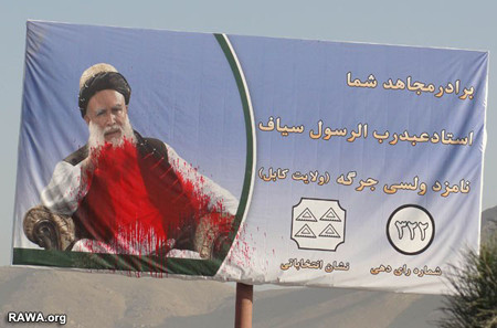 Sayyaf a notorious warlord had his elections poster defamed in Kabul