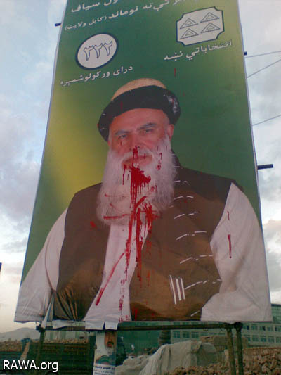 Red color on face of Sayyaf in his poster