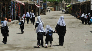 Afghan girls walk to school in the village of Istalif, about 30 kilometers north of Kabul