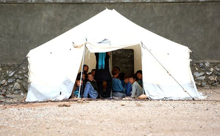 Afghan children attend class in a tent in Bamiyan province, west of Kabul
