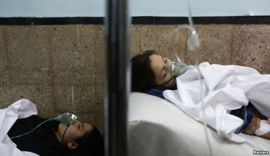Schoolgirls who fell ill after reportedly smelling gas at their school, receive treatment at a hospital in Kabul