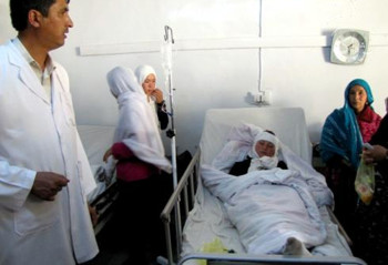 A poisoned Afghan schoolgirl receives treatment in the Bamyan Civil Hospital