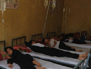 Afghan schoolgirls lie in beds in a hospital in Kabul on August 28, 2010, as they receive treatment for suspected poisoning at their school