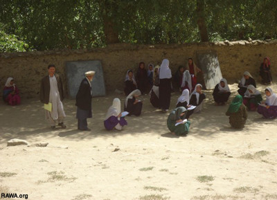 A school in Badakhshan province, where children sit on the ground or rocks to study