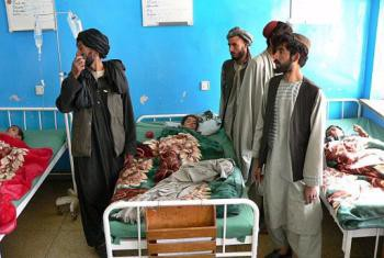 Afghan children hit by US-led air strike receive treatment at a local hospital in Kandahar