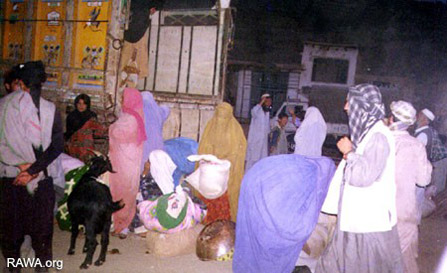 Women and children fleeing the Taliban attack on Shamali in 1999