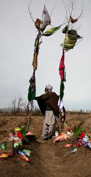 Haji Sharabuddin at his son grave