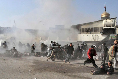 Terrified worshippers run for cover after suicide bombers killed scores of Shia Muslims in Afghanistan in December 2011