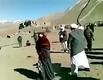 Girl being lashed in public by local cleric