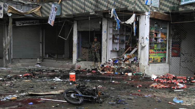 The site of a suicide bombing attack April 18 in a busy area near a bank in Jalalabad.