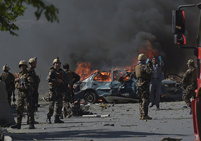 Afghan security forces personnel are seen at the site of a car bomb attack in Kabul on May 31, 2017