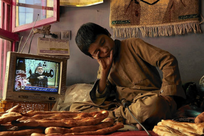 13-year-old Sami Rahimi works and lives in a bread bakery in Kabul