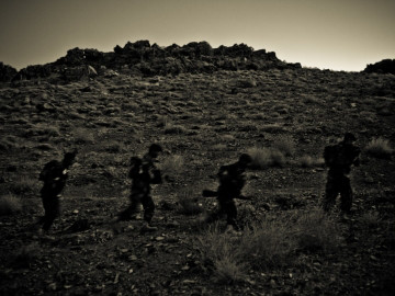 U.S. soldiers march in the cover of night